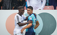 Former Watford fc teammates Bernard Mensah of Aldershot Town & Luke O'Nien of Wycombe Wanderers enjoy a chat after the match during the pre season friendly match between Aldershot Town and Wycombe Wanderers at the EBB Stadium, Aldershot, England on 22 July 2017. Photo by Andy Rowland.