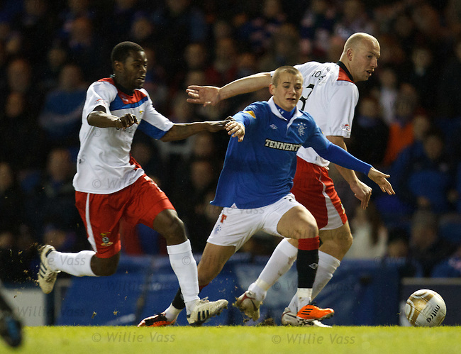 Vladimir Weiss squeezes between Eric Odhiambo and Ross Tokely