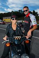 Sep 16, 2018; Mohnton, PA, USA; NHRA top fuel driver Leah Pritchett (left) and husband Gary Pritchett during the Dodge Nationals at Maple Grove Raceway. Mandatory Credit: Mark J. Rebilas-USA TODAY Sports