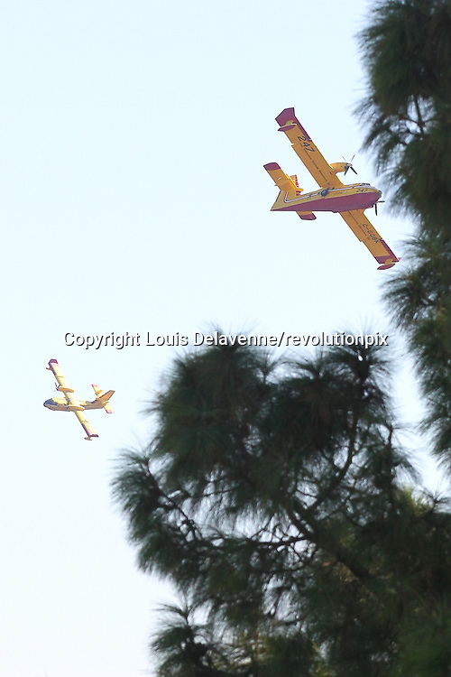Rustic Canyon Fire<br /> Los Angeles<br /> September 15 2012<br /> Fire at Rustic Canyon in Brentwood<br /> 156 fire personnel, four water-dropping helicopters and two Super Scooper planes, from the Canadian Canadair leased to Los Angeles County were assigned to the fire, which began about 12:30 p.m. in the 3000 block of Rustic Canyon Road, authorities said. By  3:30 p.m, the blaze had ignited more than 30 acres of brush in and near Topanga State Park<br /> ID revpix120915001<br /> All pictures must be credited revolutionpix