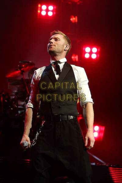 RONAN KEATING.Performing live at the Royal Albert Hall, London, England..March 9th, 2010.stage concert live gig performance music half length white shirt black waistcoat trousers 3/4 .CAP/MAR.© Martin Harris/Capital Pictures.
