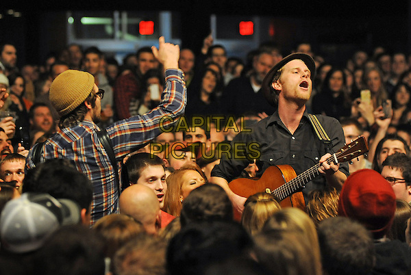 Vocalist/guitarist WESLEY SHULTZ for the American folk rock band THE LUMINEERS performs to a Sold Out concert at a stop on their U.S. tour held at the Stage AE, Pittsburgh, PA., USA..February 5th, 2013.on stage in concert live gig performance performing music half length black shirt hat guitar side hand arm in air crowd audience fans singing mouth open.CAP/ADM/JN.©Jason L Nelson/AdMedia/Capital Pictures.