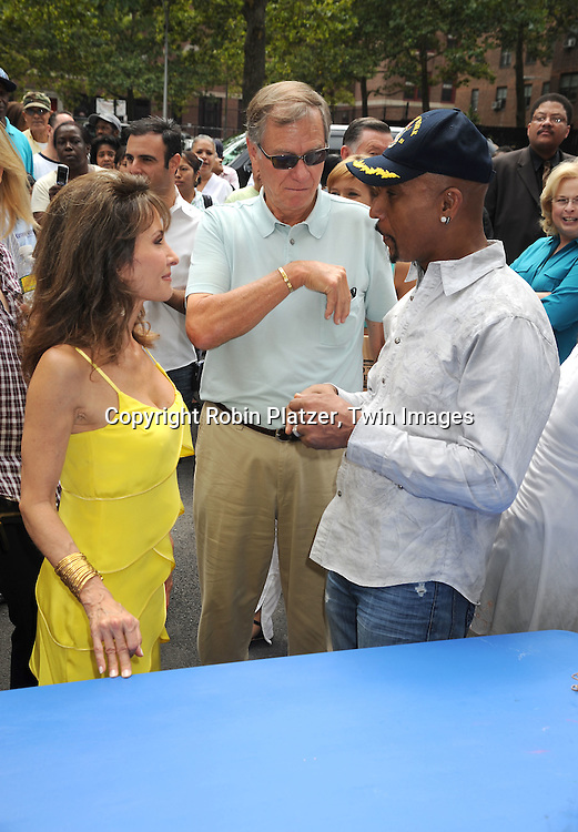 Susan Lucci and husband Helmet Huber and Montel Williams