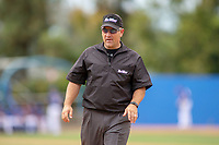 Base umpire Brad Hungerford handles the calls on the bases during the game between the Cal Poly San Luis Obispo Mustangs and the UC-Riverside Highlanders at Riverside Sports Complex on May 26, 2018 in Riverside, California. The Cal Poly SLO Mustangs defeated the UC Riverside Highlanders 6-5. (Donn Parris/Four Seam Images)