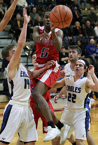 The Lakeland Eagles gutted out a 53-51 victory over Walled Lake Western in district final basketball action at Milford High School Friday, March 9, 2018. Photos: Larry McKee, L McKee Photography. PLEASE NOTE: ALL PHOTOS ARE CUSTOM CROPPED. BEFORE PURCHASING AN IMAGE, PLEASE CHOOSE PROPER PRINT FORMAT TO BEST FIT IMAGE DIMENSIONS. L McKee Photography, Clarkston, Michigan. L McKee Photography, Specializing in Action Sports, Senior Portrait and Multi-Media Photography. Other L McKee Photography services include business profile, commercial, event, editorial, newspaper and magazine photography. Oakland Press Photographer. North Oakland Sports Chief Photographer. L McKee Photography, serving Oakland County, Genesee County, Livingston County and Wayne County, Michigan. L McKee Photography, specializing in high school varsity action sports and senior portrait photography.
