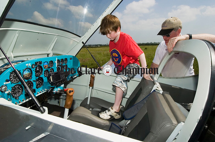 Daragh Liddy of Tulla steps aboard with help from pilot Gerry Humphries at Coonagh airfield during International Young Eagles Day in conjunction with the Limerick Flying Club. Photograph by John Kelly.