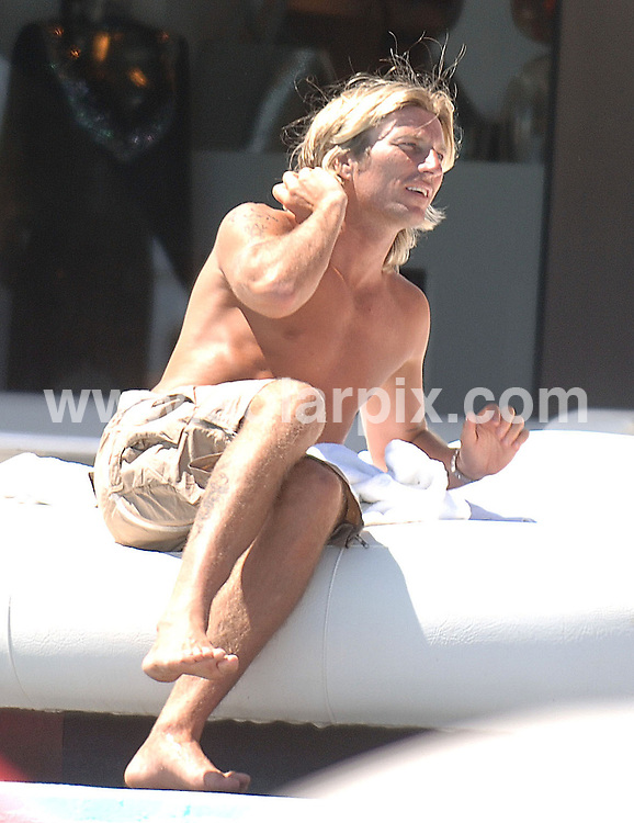 **ALL ROUND EXCLUSIVE  PICTURES FROM SOLARPIX.COM**.*MUST AGREE FEE BEFORE PUBLICATION*.**WORLDWIDE SYNDICATION RIGHTS**.The Blackburn Rovers footballer Robbie Savage and family at The Ocean Club, Puerto Banus, Marbella..JOB REF:4078-JGS        DATE:15_06_07.**MUST CREDIT SOLARPIX.COM OR DOUBLE FEE WILL BE CHARGED* *UNDER NO CIRCUMSTANCES IS THIS IMAGE TO BE REPRODUCED FOR ANY ONLINE EDITION WITHOUT PRIOR PERMISSION*