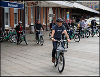 BNPS.co.uk (01202 558833)<br /> Pic: PhilYeomans/BNPS<br /> <br /> And their off - Beryl bikes launches at Bournemouth station.<br /> <br /> An innovative bike share scheme has been wheeled out in a popular seaside resort as part of a bid to reduce congestion.<br /> <br /> The Beryl Bikes, which can be hired through a smartphone app, will be dotted around designated bays in Bournemouth and Poole, Dorset.<br /> <br /> It is the first time cycling firm Beryl have offered a citywide bike-hire service and will aim to reduce traffic in the bustling coastal region.