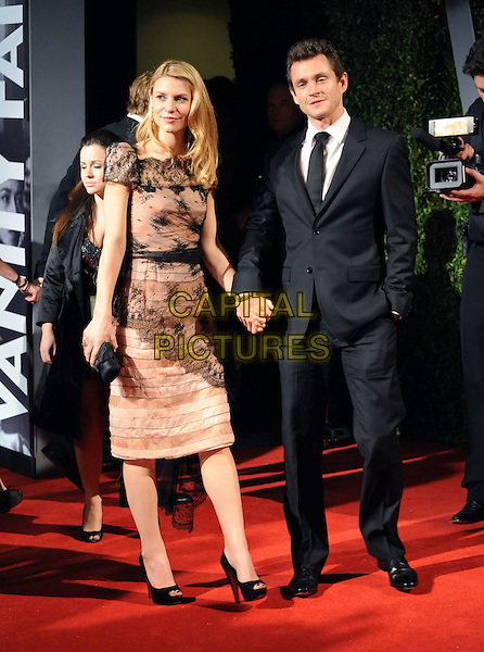 CLAIRE DANES & HUGH DANCY.The 2009 Vanity Fair Oscar Party held at The Sunset Tower Hotel in West Hollywood, California on .February 22nd, 2009.oscars full length beige pink black lace dress open toe shoes couple holding hands suit .CAP/DVS.©Debbie VanStory/Capital Pictures.