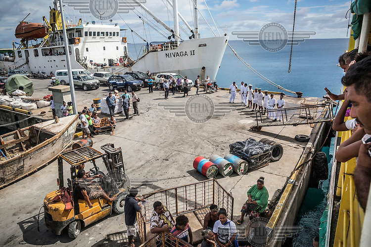 People waiting waiting for the 'Manu Folau' to depart the port for the atolls of Nui, Vaitupu and Nukufetau in the northern and central parts of Tuvalu. The island nation has only two ships, the 'Manu Folau' and the 'Nivaga II', that travel between the outer islands (which are accessible only by boat) transporting goods and passengers.