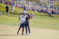 Brooks Koepka (USA) is congratulated by his caddie on the 18th green after winning the 118th U.S. Open Championship at Shinnecock Hills Golf Club in Southampton, NY, USA. 17th June 2018.<br /> Picture: Golffile | Brian Spurlock<br /> <br /> <br /> All photo usage must carry mandatory copyright credit (&copy; Golffile | Brian Spurlock)