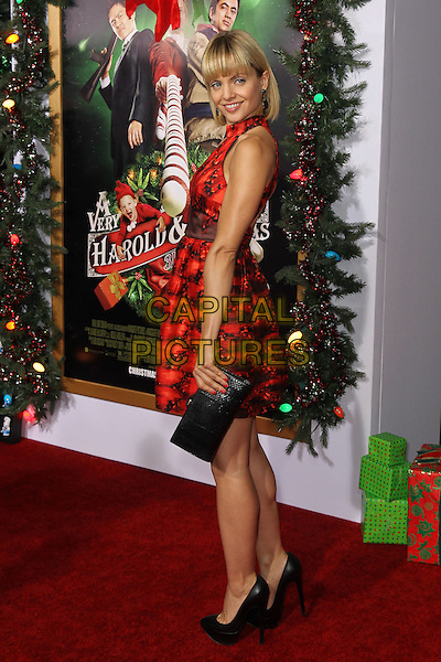 Mena Suvari.'A Very Harold & Kumar 3D Christmas' Los Angeles premiere, Grauman's Chinese Theatre, Hollywood, California, USA..2nd November 2011.full length red black print dress clutch bag side sleeveless .CAP/CEL .©CelPh/Capital Pictures.
