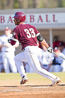 Dre Watts #33 of the College of Charleston Cougars follows through on his swing against the Davidson Wildcats at Wilson Field on March 12, 2011 in Davidson, North Carolina.  The Wildcats defeated the Cougars 8-3.  Photo by Brian Westerholt / Four Seam Images