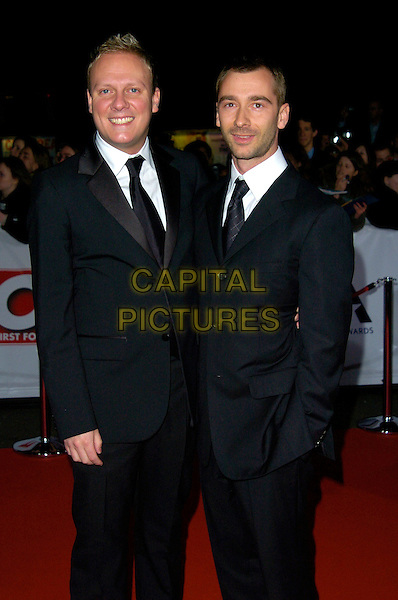 ANTONY COTTON & CHARLIE CONDU.The National Television Awards, Royal Albert Hall, London, England..October 31st, 2007.TV NTA half length 3/4 black suit anthony.CAP/CAN.© Can Nguyen/Capital Pictures