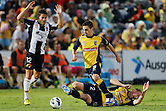 James Virgili of The Central Coast Mariners recovers the ball from fellow teammate Daniel McBreen during the round 17 A-League match at Bluetongue Stadium on January 19, 2013 in Gosford, Australia. (Photo by Paul Barkley/LookPro)