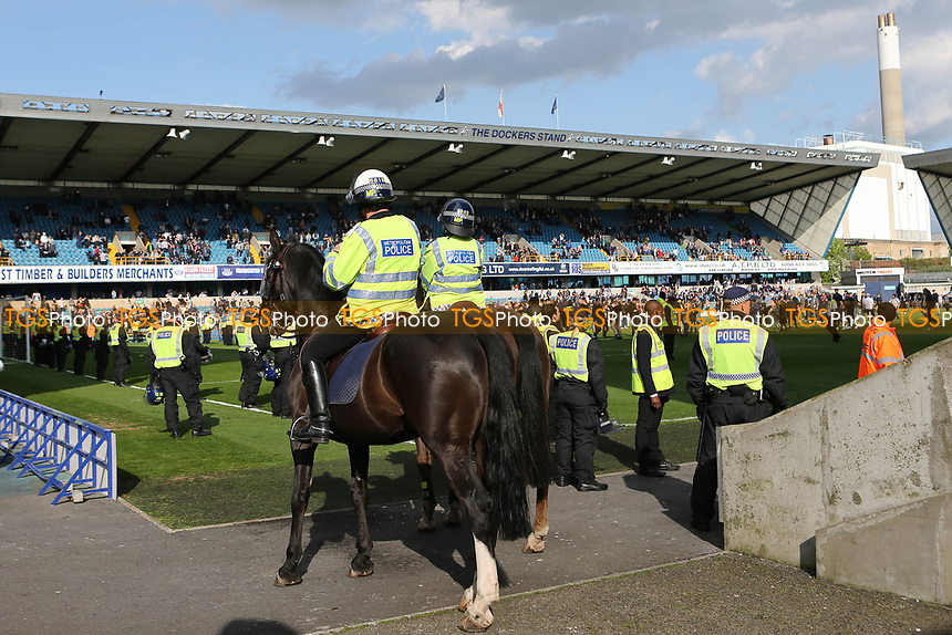 Mounted Police get into position at the side of the pitch in case they are needed as fans invade the pitch at the final whistle during Millwall vs Oxford United, Sky Bet EFL League 1 Football at The Den on 22nd April 2017