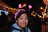 Portrait of young girl standing in street to celebrate Diwali; festival of light; wearing heart shaped deely boppers,