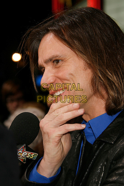 "JIM CARREY &.""The Number 23"" Los Angeles Premiere held at the Orpheum Theater, Los Angeles, California, USA..February 13th, 2007.headshot portrait profile hand.CAP/ADM/RE.©Russ Elliot/AdMedia/Capital Pictures *** Local Caption *** .."