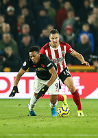 24th November 2019; Bramall Lane, Sheffield, Yorkshire, England; English Premier League Football, Sheffield United versus Manchester United; Anthony Martial of Manchester United is fouled from behind by Phil Jagielka  of Sheffield United - Strictly Editorial Use Only. No use with unauthorized audio, video, data, fixture lists, club/league logos or 'live' services. Online in-match use limited to 120 images, no video emulation. No use in betting, games or single club/league/player publications