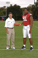 7 August 2006: Stanford Cardinal head coach Walt Harris and Pannel Egboh during Stanford Football's Team Photo Day at Stanford Football's Practice Field in Stanford, CA.