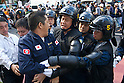 August 15, 2011, Tokyo, Japan - A member of the right-wing group Gishin Gokoku-kai scuffles with Police who are trying to prevent right-wing groups getting to left-wing demonstrators holding a demonstration against Yasukuni shrine. (Photo by Bruce Meyer-Kenny/AFLO) [3692]