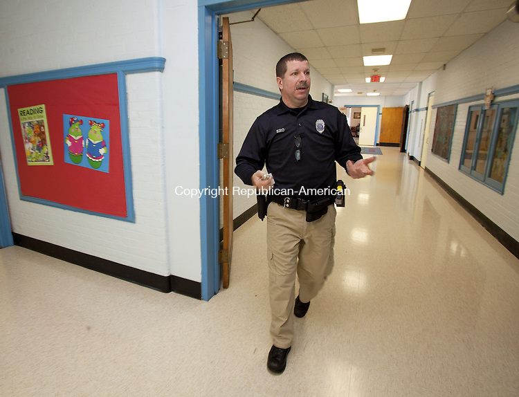 WOODBURY, CT-13 November 2013-111313BF02- School Resource Officer Craig Tibbals checks safety and visits with students and teachers daily at Mitchell Elementary School in Woodbury. Officer Craig, as he is known to students, started as the school resource officer at the school in September and is at the school each day students are present. Bob Falcetti Republican-American