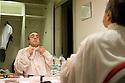 """Silvio Orlando, actor, wears the costume in dressing room at Elfo- Puccini Theatre, Milan, March 2013. Orlando plays and is also the director of the theatrical piece """"Rameau's Nephew"""" by Denis Diderot on stage . © Carlo Cerchioli..Silvio Orlando, attore, indossa il costume di scena nel camerino del Teatro Elfo-Puccini, Milano marzo 2013. Orlando recita ed è anche il regista della piece teatrale """"Il nipote di Rameau"""" di Denis Diderot in scena al teatro.."""