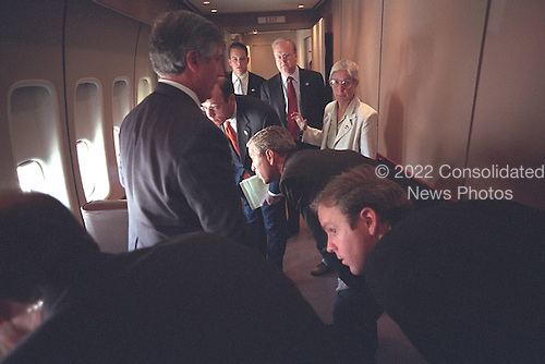 United States President George W. Bush looks out the window of Air Force One with Press Secretary Ari Fleischer and other staff en route from Sarasota, Florida, to Shreveport, Louisiana, Tuesday, September 11, 2001..Mandatory Credit: Eric Draper - White House via CNP.