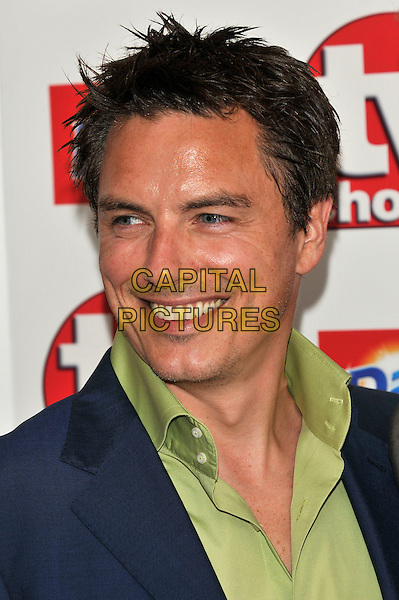 JOHN BARROWMAN .Attending the TV Choice Awards 2010 at The Dorchester, London, England, UK, September 6th, 2010..arrivals portrait headshot green shirt blue smiling .CAP/PL.©Phil Loftus/Capital Pictures.