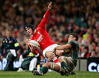 Photo: Richard Lane/Richard Lane Photography..Wales v South Africa. Prince William Cup. 24/11/2007. .Wales' Tom James is tackled by South Africa's Ryan Kankowski.
