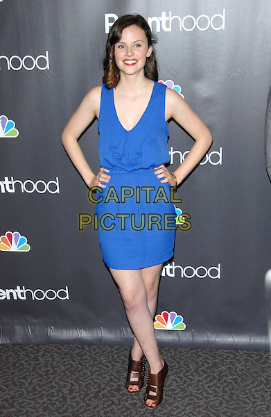 "SARAH RAMOS.at the NBC Universal's ""Parenthood"" Premiere Screening held at The DGA in West Hollywood, California, USA..February 22nd, 2010                      .full length blue sleeveless dress brown leather sandals ankle open toe hands on hips .CAP/RKE/DVS.©DVS/RockinExposures/Capital Pictures."