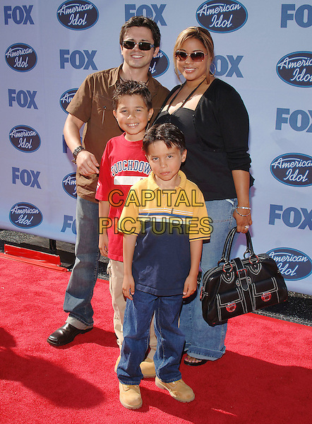 "FREDDY RODRIGUEZ & FAMILY.""American Idol"" Season 4 Finale held at The Kodak Theatre..May 25th, 2005.Photo Credit: Jacqui Wong/AdMedia.full length sunglasses shades black leather bag.www.capitalpictures.com.sales@capitalpictures.com.© Capital Pictures."