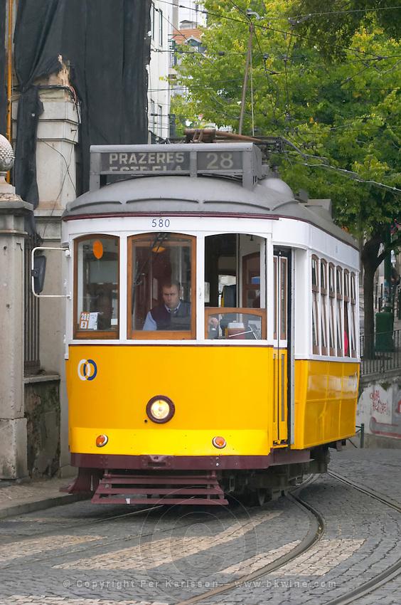 Old tram. At Miradouro de Santa Luzia. Street view. Alfama district. Lisbon, Portugal