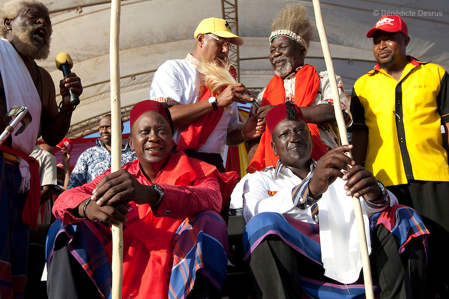 28 february 2013 - Mombasa, Kenya - Kenya's Deputy Prime Minister and Presidential candidate Uhuru Kenyatta from The National Alliance (TNA) (L) and and his running mate, William Ruto (R) sit on traditional chairs after being endorsed by some elderls from the coastal Mijikende tribes at an election rally at the Khadijah Primary School in Mombasa, Kenya. General elections will be held in Kenya on 4 March 2013. They will be the first elections held under Kenya's new constitution, promulgated in 2010. The last Kenya's elections left more than 1000 people dead and 650,000 displaced. Presidential candidate Uhuru Kenyatta is facing charges of crimes against humanity at the International Criminal Court (ICC) for his role in inciting the 2007-2008 post-election violence. Photo credit: Benedicte Desrus