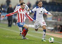 Getafe's Diego Castro against Atletico de Madrid's Juanfran Torres during King's Cup match. December 12, 2012. (ALTERPHOTOS/Alvaro Hernandez) /NortePhoto