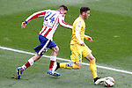 Atletico de Madrid's Jose Maria Gimenez (l) and Getafe's Alvaro Vazquez during La Liga match.March 21,2015. (ALTERPHOTOS/Acero)
