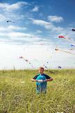 USA, Washington State, Long Beach Peninsula, portrait of a boy with his kite at the International Kite Festival