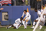 20 March 2008: Freddy Adu (USA) (11) slips while celebrating his second goal with teammates Sacha Kljestan (USA) (16), Maurice Edu (USA) (6), and Stuart Holden (USA) (7). The United States U-23 Men's National Team defeated the Canada U-23 Men's National Team 3-0 at LP Field in Nashville,TN in a semifinal game during the 2008 CONCACAF Men's Olympic Qualifying Tournament. With the victory, the United States qualified for the 2008 Beijing Olympics.