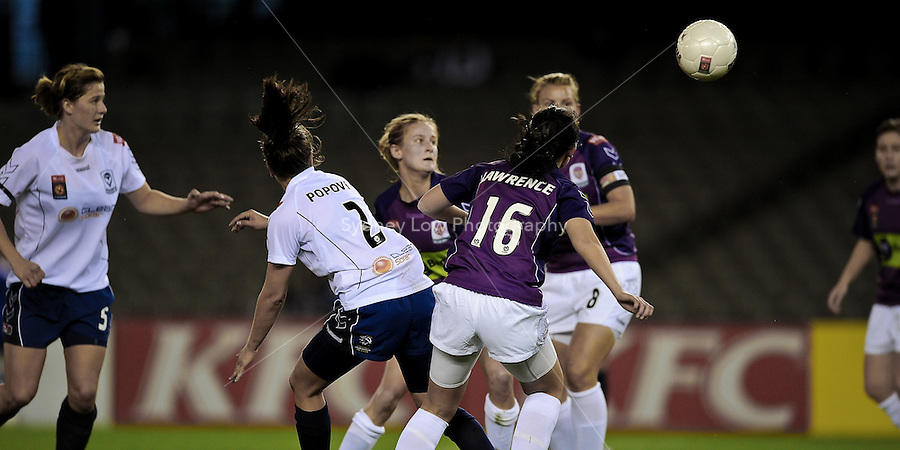 MELBOURNE, AUSTRALIA - OCTOBER 03: Players contest a loose ball in round 1 of the Westfield W-league match between Melbourne Victory and Perth Glory at Etihad Stadium on 3 October 2009 in Melbourne, Australia. (Photo by Sydney Low http://syd-low.com)