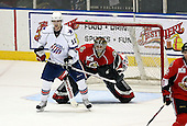 February 22nd 2008:  Brian Elliott (1) of the Binghamton Senators looks around the screen of Stefan Meyer (10) during a game vs. the Rochester Amerks at Blue Cross Arena at the War Memorial in Rochester, NY.  The Senators defeated the Amerks 4-0.   Photo copyright Mike Janes Photography
