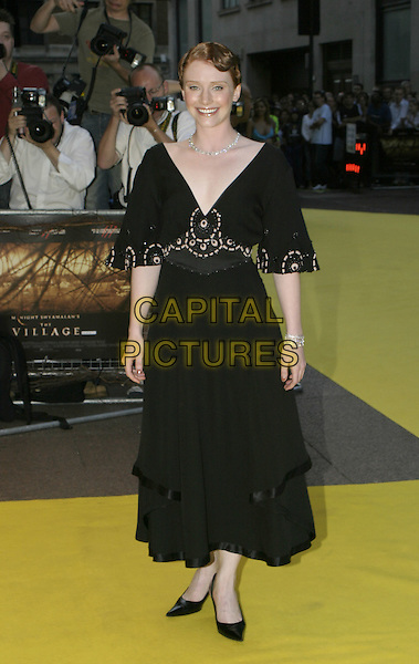BRYCE DALLAS HOWARD.UK Premiere of M. Night Shyamalan's The Village at Odeon West End Leicester Square, London W1.August 10th, 2004.full length, black dress, silk, satin trim, embroidered, black heels, plunging neckline.www.capitalpictures.com.sales@capitalpictures.com.© Capital Pictures.