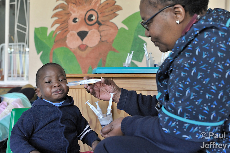 Mapule Maganedisa, a nurse at the St. Francis Care Centre's Rainbow Cottage for Babies in Johannesburg, South Africa, administers antiretroviral medication to George, a child living with HIV. The centre is a project of the Roman Catholic Archdiocese of Johannesburg, and is supported by Catholic Relief Services, a member of the Ecumenical Advocacy Alliance.