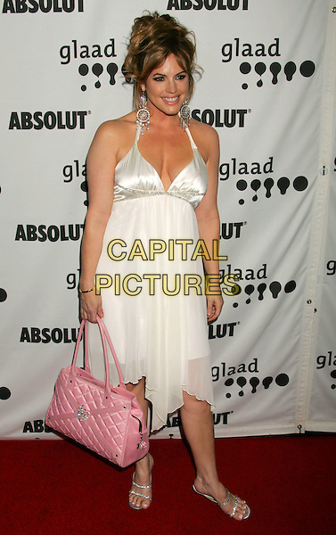 SANDRA TAYLOR.The 17th Annual GLAAD Media Awards - Arrivals..Los Angeles, California, USA,.8 April 2006.full length white halterneck dress pink bag.Ref: ADM/RE.www.capitalpictures.com.sales@capitalpictures.com.©Russ Elliot/AdMedia/Capital Pictures.