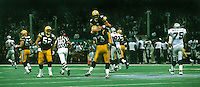 On the second play of Super Bowl XXXI between the Green Bay Packers and the New England Patriots on January 26, 1997 at the Supderdome in New Orleans, Brett Favre celebrates after completing a 54-yard touchdown pass. The Packers won the game 35-21.