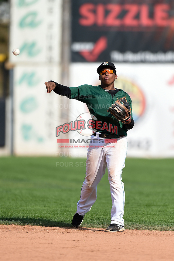 Clinton LumberKings second baseman Martin Peguero (7) throws to first during a game against the Beloit Snappers on August 17, 2014 at Ashford University Field in Clinton, Iowa.  Clinton defeated Beloit 4-3.  (Mike Janes/Four Seam Images)