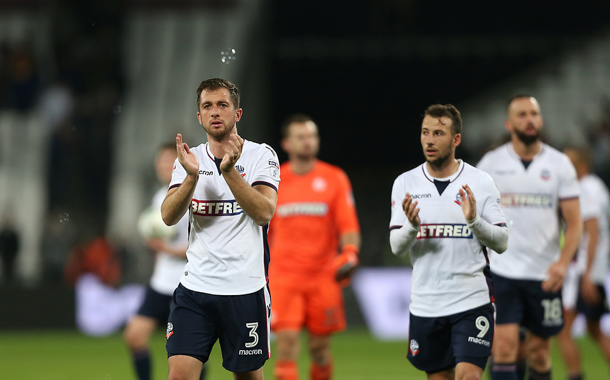 Bolton Wanderers' Andrew Taylor leads the applauds to the Bolton fans at the end of the game<br /> <br /> Photographer Rob Newell/CameraSport<br /> <br /> Carabao Cup 3rd Round - West Ham United v Bolton Wanderers - Tuesday 19th September 2017 - London Stadium, Stratford<br /> <br /> World Copyright &copy; 2017 CameraSport. All rights reserved. 43 Linden Ave. Countesthorpe. Leicester. England. LE8 5PG - Tel: +44 (0) 116 277 4147 - admin@camerasport.com - www.camerasport.com