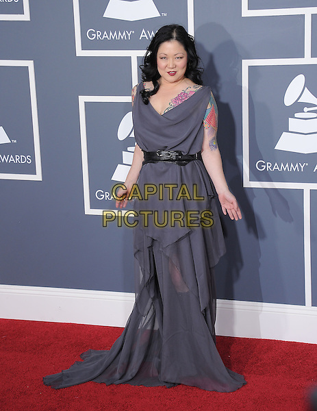 MARGARET CHO .attending The 53rd Annual GRAMMY Awards held at The Staples Center in Los Angeles, California, USA,.February 13th 2011..arrivals grammys grammys full length grey gray long maxi dress ruffle belt black  tattoo .CAP/RKE/DVS.©DVS/RockinExposures/Capital Pictures.