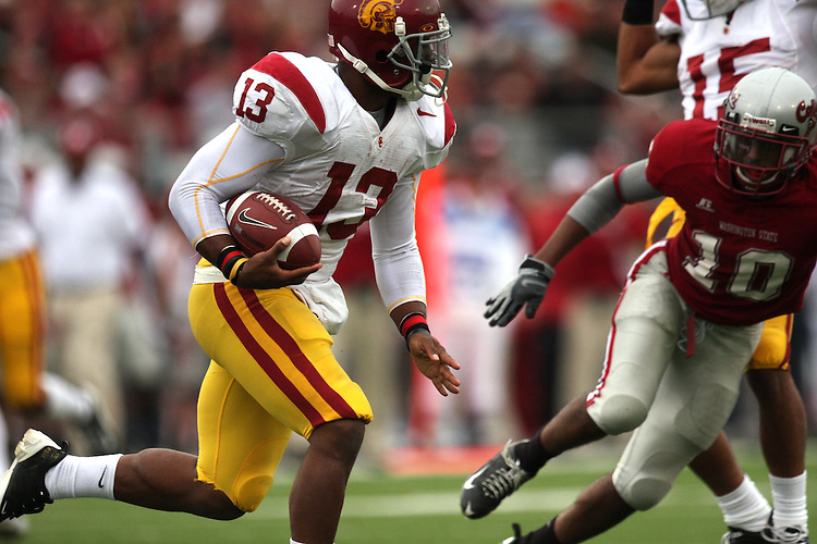 Stafon Johnson (#13), Southern Cal running back, looks for daylight while being pursued by Washington State defensive back Romeo Pellum (#10) during the Trojans game against the Cougars on October 18, 2008, at Martin Stadium in Pullman, Washington.  USC won the game 69-0 to solidify their spot as one of the top college football teams in the country.