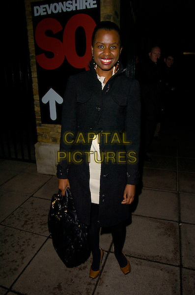 JUNE SARPONG.at Alesha Dixon's End of Year Party at Kenza restaurant..29th December 2007 London, England.full length black coat bag.CAP/CAN.©Can Nguyen/Capital Pictures.