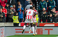 Eric Maxim Choupo-Moting of Stoke City celebrates his second goal by dancing with Kurt Zouma of Stoke City during the Premier League match between Stoke City and Manchester United at the Britannia Stadium, Stoke-on-Trent, England on 9 September 2017. Photo by Andy Rowland.